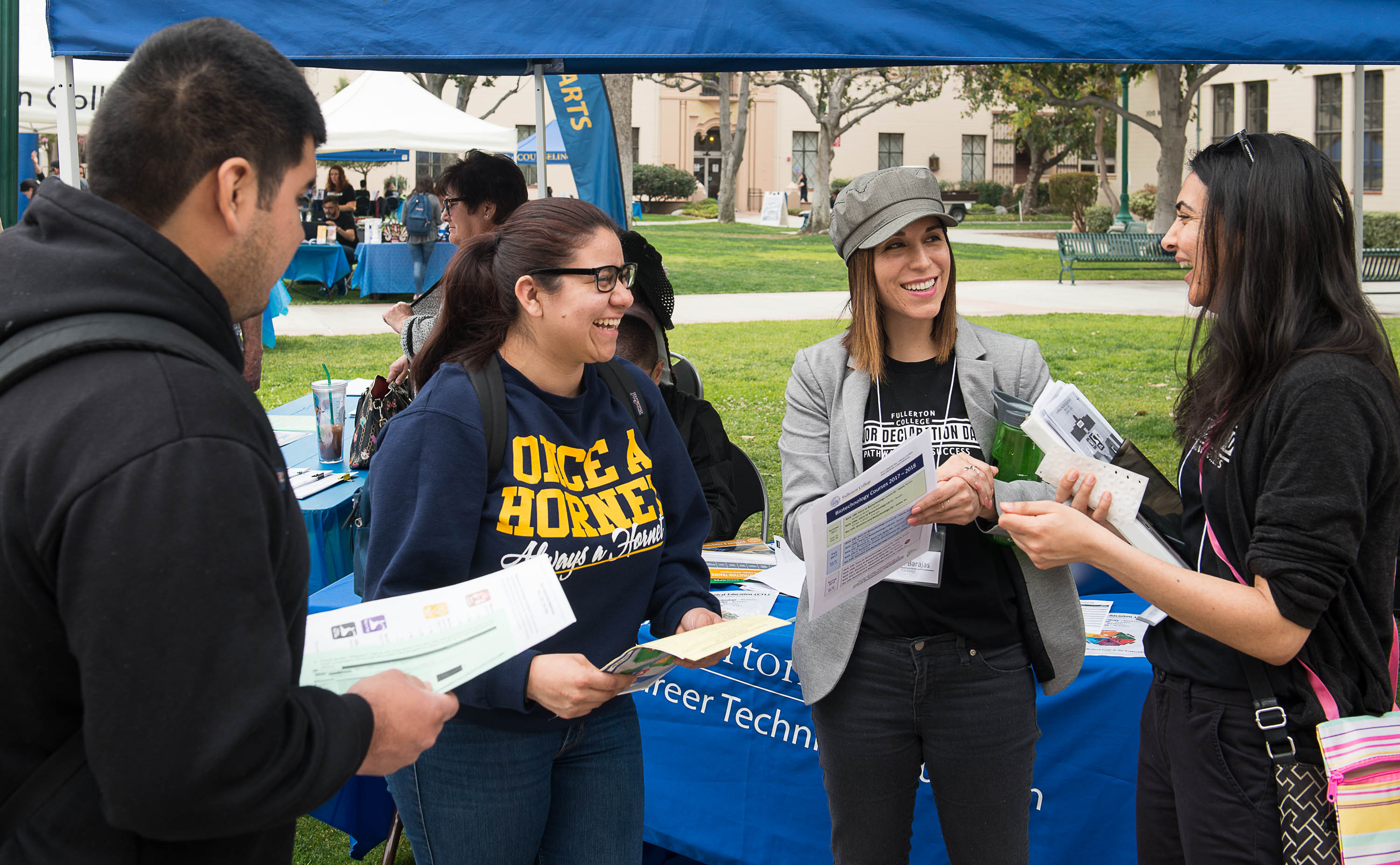 Students talk to counselors during Major Declaration Day, an event held on the campus quad.